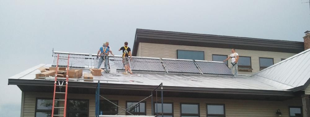 MREA TRAINING CENTER - INSTALLATION IN PROCESS:  Five SunQuest 250 solar thermal panels were installed by employees and volunteers for this sustainability training facility in Custer, Wisconsin.